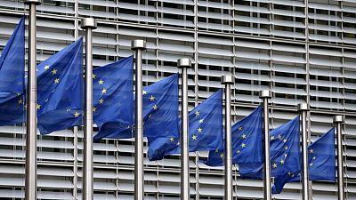 EU, U.S. to end trade tariffs, call for new study into COVID-19 origins, summit draft says