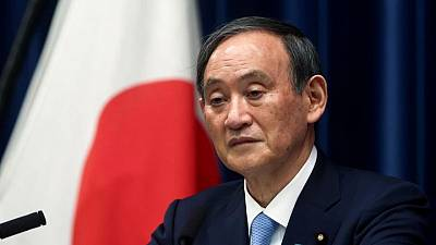 Japan will aim to meet fiscal targets, raise minimum wage - PM