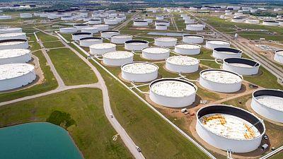 Oil slips as start of U.S. summer driving season fails to lift fuel demand
