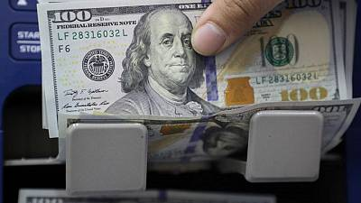 Dollar little changed as traders seek direction from Fed meeting