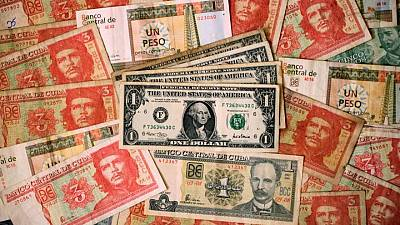 Cuba suspending cash bank deposits in dollars, citing U.S. sanctions