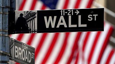 Stocks hover near record highs as bond yields slide