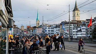 Swiss plan to ease entry, loosen public life as virus cases wane
