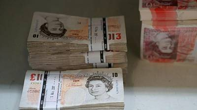 """British pound drops as investors seek safety on """"Freedom Day"""""""