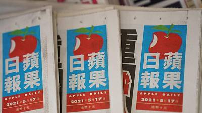 HK national security police arrest Apple Daily directors, seize reporting materials
