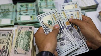 Dollar hits two-month highs on Fed's hawkish surprise; kiwi climbs after GDP