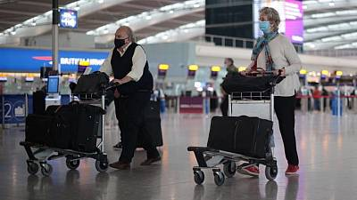 Travel for the vaccinated? We're looking at all options, UK minister says
