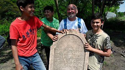 Roma boys help restore forgotten Slovak Jewish cemetery