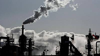 Global carbon price floor would limit global warming - IMF staff