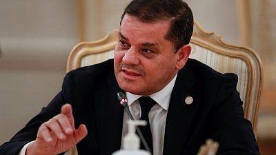 Libyan unity PM says coast road reopened ahead of Berlin talks