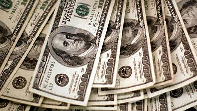 Dollar catches breath as traders await Powell testimony
