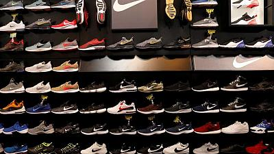 Nike shares hit record high as sales get post-lockdown boost