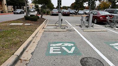 Biden's EV charging push boosts established automakers taking on Tesla