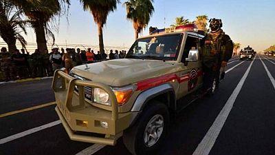 Iraq paramilitaries show off weaponry in big, anniversary parade