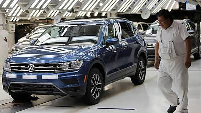 Volkswagen's Mexico unit says it will resume production that was hit by chip shortage