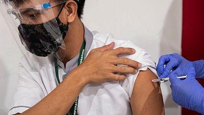 Philippines extends coronavirus curbs until mid-July