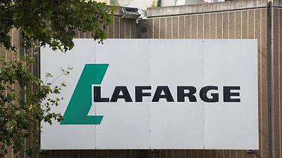 Extinction Rebellion targets LafargeHolcim cement plant in Paris
