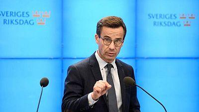 Swedish right-wing hopeful seeks to woo centrists in PM bid