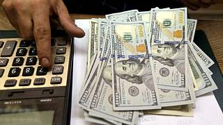 Dollar near one-month low, set for worst weekly showing since May