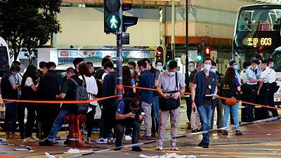 """Hong Kong policeman was stabbed in """"lone wolf"""" attack- security chief"""