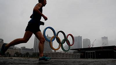 Tokyo goes to the polls as pandemic-shadowed Olympics loom