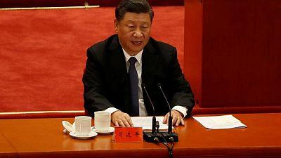 China's Xi tells Macron, Merkel he hopes to expand cooperation with Europe