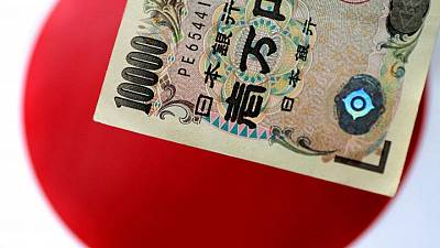 Japan's households, firms keep saving on prolonged impact of pandemic