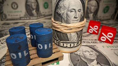 Analysis - Big Oil keeps brakes on spending even with crude rally windfall