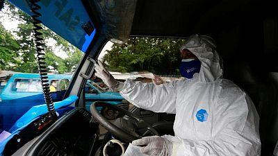 Volunteer ambulance drivers help take the strain on Indonesia's COVID frontline