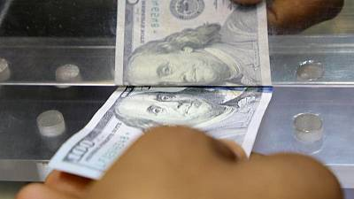 Dollar regroups after Powell push