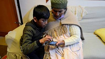 Bolivian parents go back to class to help their kids study online