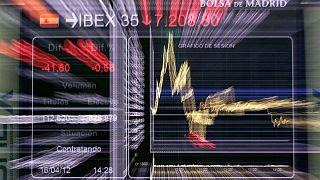 Bolsa española recoge beneficios, mercado espera reunión de la Fed