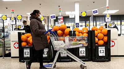 UK supermarkets ask shoppers to keep wearing masks