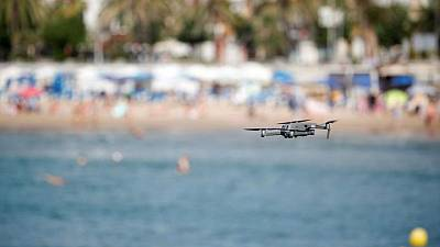 As Spain's beaches fill up, a seaside resort sends in the drones