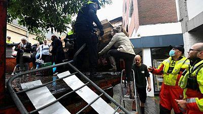 Hundreds flee as flood waters breach Dutch defences