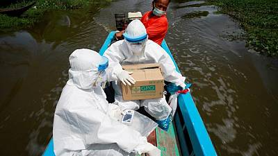 Thai health workers use canals to get to remote COVID-19 patients