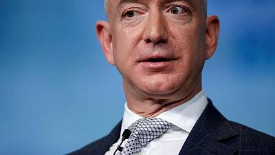 Factbox-Jeff Bezos' journey from suburban garage to edge of space