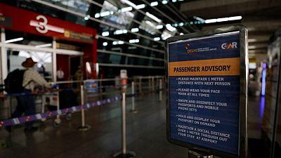 U.S. eases COVID-19 travel advisory for India, Pakistan