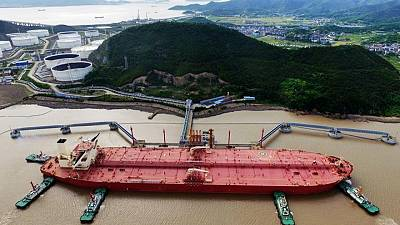 Oil retreats on surprise rise in U.S. crude stocks