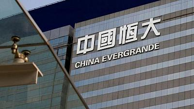 HSBC, StanChart halt new loans to two HK projects by Evergrande, brokers say