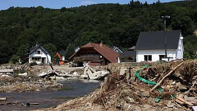German flood survivors emerged from homes 'like ghosts'