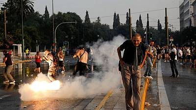 Greek police, protesters clash in protest against COVID vaccines