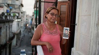 As Cuba begins handing out sentences to protesters, some families left in the dark