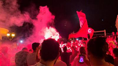 Supporters of Tunisian president celebrate government ousting with cheers, fireworks
