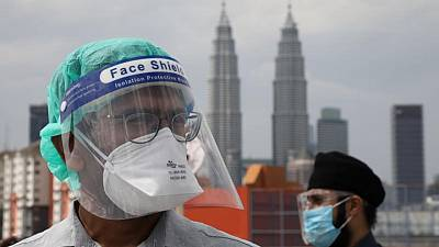 Southeast Asia COVID-19 cases hit new highs, Malaysian doctors protest
