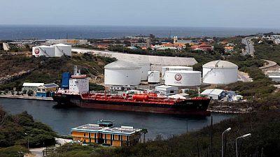 Oil rises on U.S. fuel drawdowns despite surging coronavirus cases