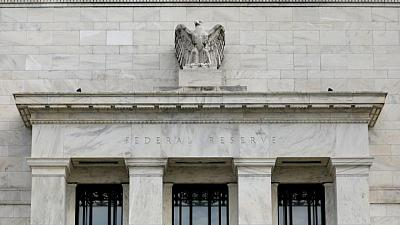 Fed says economy continues to 'strengthen,' cites progress on bond taper goals