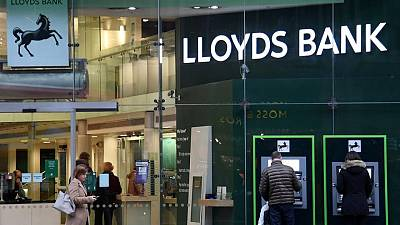 Lloyds swings to half-year profit, announces dividend