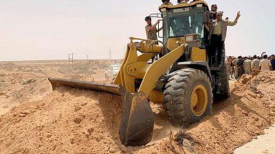 Libya's combatants declare key coast road open