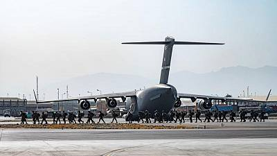 U.S. urges Americans to keep clear of Kabul airport as crowd chaos grows